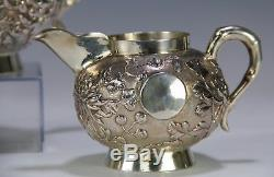 Nice Three Piece Chinese Export Silver Tea Set With Relief Flowers